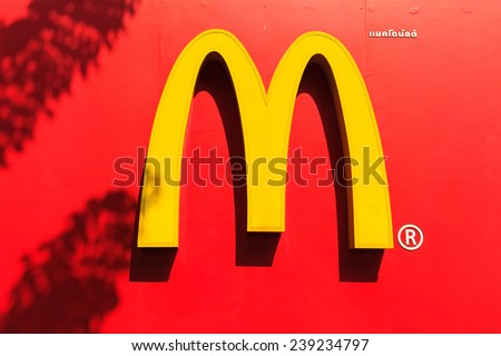 BANGKOK, THAILAND- DECEMBER 22, 2014: McDonalds logo sign in Bangkok on 22 December 2014 in Bangkok. It is the world's largest chain of hamburger fast food restaurants. - stock photo