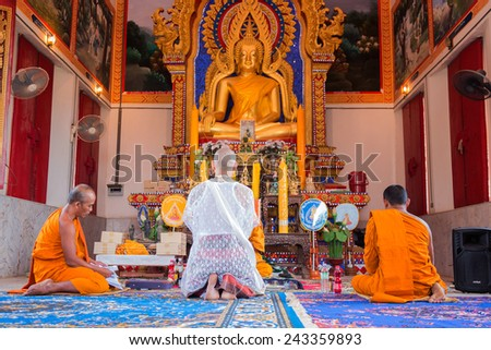 BANGKOK,THAILAND December 4: Newly ordained Buddhist monk pray with priest procession. Newly ordained Buddhist monks have a ritual in the temple procession in December 4, 2014 - stock photo