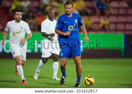 BANGKOK, THAILAND - DECEMBER 05: Patrik Berger (blue)of Team Cannavaro runs with the ball  during the Global Legends Series match, at the SCG Stadium on December 5, 2014 in Bangkok, Thailand. - stock photo