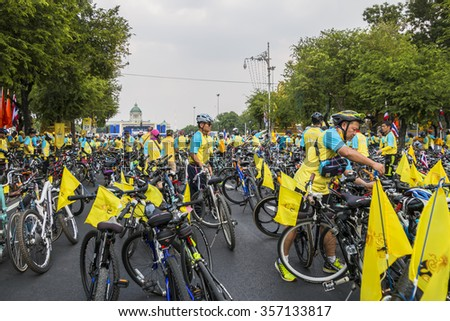 BANGKOK, THAILAND - December 11, 2015: People ride bicycles in Bike For Dad event, purpose is to grateful to father and respect to the King of Thailand on December 11, 2015 in Bangkok, Thailand  - stock photo