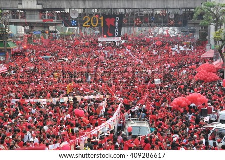 Bangkok, Thailand - December 19, 2010: Thousands of anti government Red Shirt protesters defy an emergency decree to protest at Ratchaprasong Junction in the city centre. - stock photo