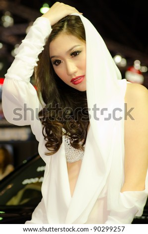 BANGKOK, THAILAND - DECEMBER 6: Unidentified female presenter at BARBUS booth in THE 28th THAILAND INTERNATIONAL MOTOR EXPO 2011 on December 6, 2011 in Bangkok, Thailand. - stock photo