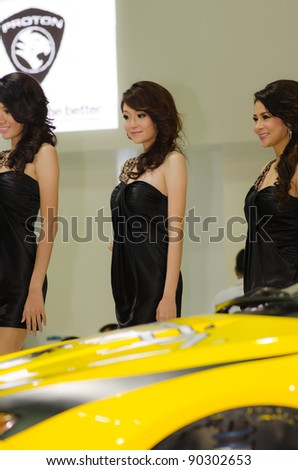 BANGKOK, THAILAND - DECEMBER 6: Unidentified female presenter at Proton booth in THE 28th THAILAND INTERNATIONAL MOTOR EXPO 2011 on December 6, 2011 in Bangkok, Thailand. - stock photo