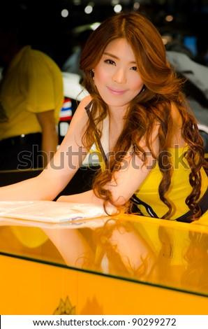 BANGKOK, THAILAND - DECEMBER 6: Unidentified female presenter at Singha beer booth in THE 28th THAILAND INTERNATIONAL MOTOR EXPO 2011 on December 6, 2011 in Bangkok, Thailand. - stock photo