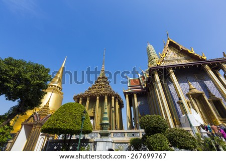 BANGKOK, THAILAND - DECEMBER 27 : Wat Phra Kaew, Temple of the Emerald Buddha and the home of the Thai King  on December 27, 2013 in Bangkok, Thailand.  - stock photo