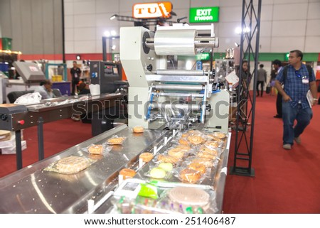 BANGKOK ,THAILAND - FEBRUARY 7: Horizontal packaging machine At THAILAND  Industrial Fair 2015 And Food Pack Asia 2015 on February 7, 2015 in  Bangkok, Thailand. - stock photo