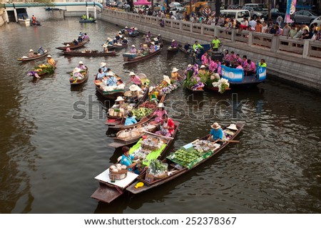 BANGKOK,THAILAND - FEBRUARY 12 : New floating market along the canal ,The event aims to recapture historical Thai canal culture and traditional Thai foods on February 12,2015 in Bangkok,Thailand. - stock photo