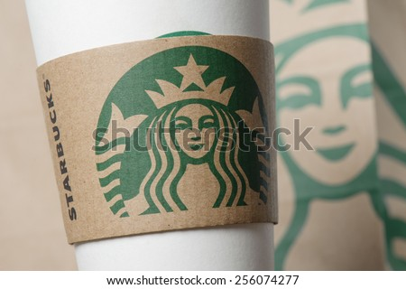 BANGKOK, THAILAND - FEBRUARY 26, 2015: Starbucks logo on sleeve. Starbucks is the world's largest coffee house with over 20,000 stores in 61 countries. - stock photo