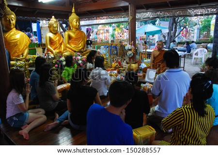 BANGKOK, THAILAND - FEBRUARY 18: The unidentified Buddhists offering dedicated to Buddhist monks in Magha Puja Day at Wat Pra Sri Mahathat Bangkhen on FEBRUARY 18, 2011 in Bangkok, Thailand - stock photo