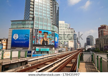BANGKOK, THAILAND - FEBUARY 19, 2014: BTS Skytrain elevated rails in Asoke district. Elevated rails cover business, resident, and tourist areas by 32 stations. - stock photo