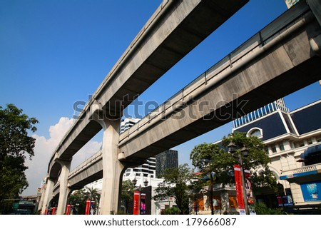 BANGKOK, THAILAND - FERBUARY 19, 2014: BTS Skytrain elevated rails at Ratchaprasong in Pathum Wan District. Elevated rails cover business, resident, and tourist areas by 32 stations. - stock photo