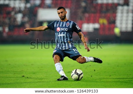 BANGKOK,THAILAND-JAN 22:Adnan Barakat of SCG Muangthong in action during match SCG Muangthong Utd and Gyeongnam FC. at SCG Stadium on  JANUARY22,2013in,Thailand - stock photo