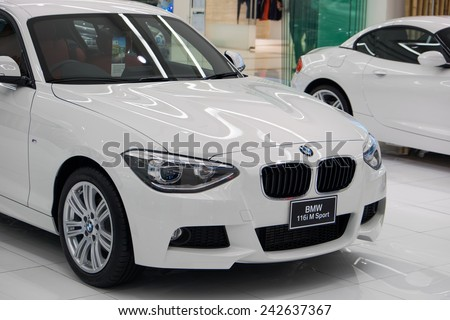 BANGKOK, THAILAND - JAN 08 2015 : BMW 116i M Sport on display at The showroom in Siam Paragon which is the biggest shopping mall in Thailand. - stock photo