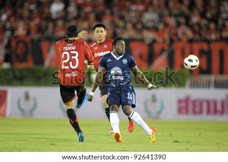 BANGKOK, THAILAND - JAN 11:  Franck Ohandza Zoa of the Buriram PEA (L) in action during the Thaicom FA Cup Final match  between MuangThong United at National Stadium on Jan11,2012 in Bangkok Thailand. - stock photo