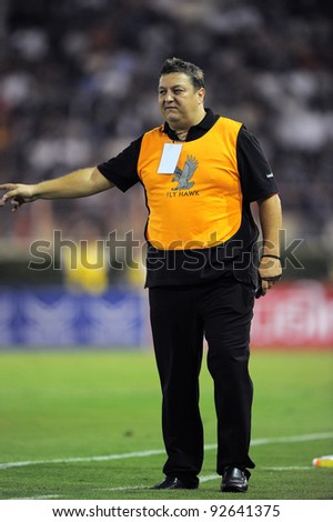 BANGKOK, THAILAND - JAN 11:  Head Coach Milos Josic of the MuangThong United in action during theThaicom FA Cup Final match between and Buriram PEA at National Stadium on January11,2012 in Bangkok Thailand. - stock photo