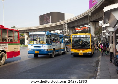 BANGKOK, THAILAND - JAN 3 : Public transport bus stop at Victory monument with skytrain track on background on Jan 3,2015. - stock photo