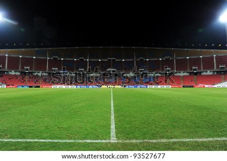 BANGKOK THAILAND-JAN15:Rajamangala stadium  during the 41st King's cup football between Thailand(Y) and KoreaRep(R)at Rajamangala stadium on Jan15,2012 in Bangkok,Thailand. - stock photo