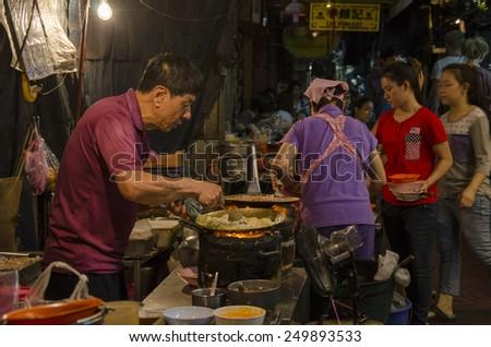 Bangkok, Thailand - 31 January 2015 : chinese chef cooking a chinese food at bangkok chinatown on Yaowarat Road, many chinese food vendor around bangkok chinatown. - stock photo