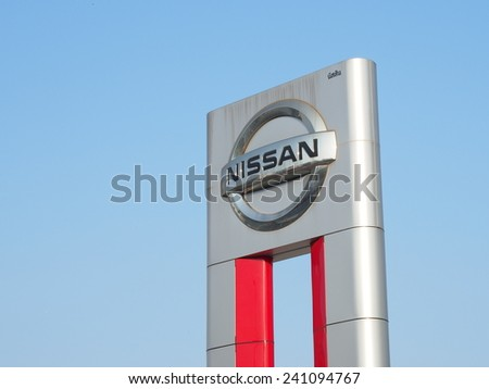 BANGKOK, THAILAND - JANUARY 2: Nissan Motors automobile dealership sign in Bangkok, Thailand on January 2, 2015. NISSAN is a Japanese car manufacturer and one of the biggest in Japan. - stock photo