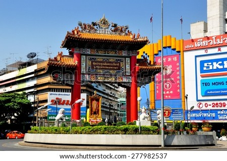 Bangkok, Thailand - January 16, 2013:  Ornate ceremonial entry gate to Chinatown with ceramic dragons and hand-painted decorations at Yaworat Road    - stock photo