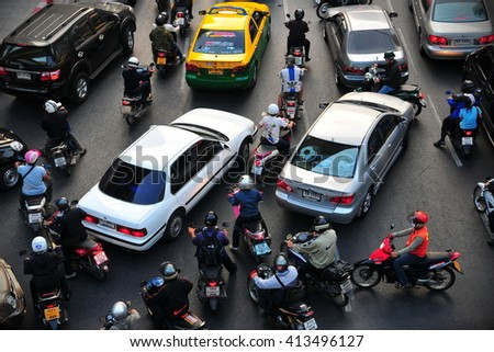 Bangkok, Thailand - January 13, 2011: Traffic moves slowly on a busy city centre road. Annually an estimated 150,000 new cars join the heavily congested roads of the Thai capital. - stock photo