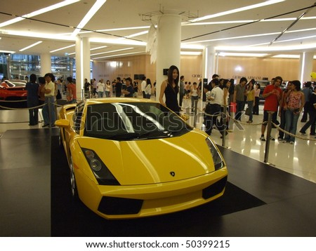 BANGKOK, THAILAND - JANUARY 8: Yellow Lamborghini inside the Siam Paragon shopping center at the grand opening. January 8 2005, Siam center, Bangkok. - stock photo