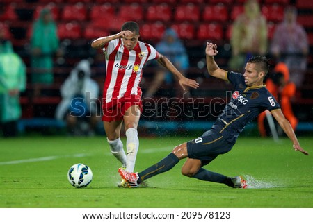 BANGKOK THAILAND-Jul 30:Wellington Silva (L) of UD Almeria in action during the LFP World Challenge 2014 between Muangthong UTD. and UD Almeria at SCG Stadium on July30,2014,Thailand - stock photo