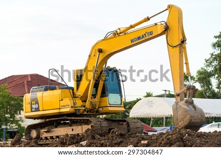 Bangkok, Thailand- July 17: Backhoe on the construction of a Condominium near the town of Bangkok on July 14, 2015 in Bangkok, Thailand.  - stock photo