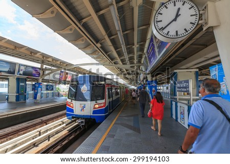 Bangkok, Thailand - July 23, 2015: Commuters  walk in BTS elevated rails, It's the first electric train system in Thailand. - stock photo