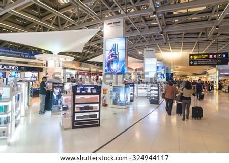 BANGKOK, THAILAND - 15 JULY 2014: Duty free shopping area near the departure gates of one of Suvarnabhumi Airport's main terminals. - stock photo