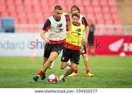 BANGKOK,THAILAND-July13:Rickie Lambert (L) of Liverpool control the ball during a training session at Rajamangala Stadium on July 13, 2015, in BangkokThailand. - stock photo