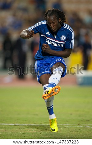 BANGKOK,THAILAND-JULY17: Romelu Lukaku of Chelsea in action during the international friendly match Chelsea FC and Singha Thailand All-Star XI at the Rajamangala Stadium on July17, 2013 in Thailand. - stock photo