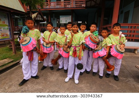 BANGKOK, THAILAND - JULY 29, 2015 : Student of Pieamsuwan school, Long Drum Parade in Thai candle festival of buddha (The Buddhist Lent Day) in Bangkok, Thailand. - stock photo