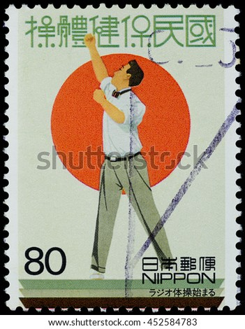 "BANGKOK, THAILAND - JUNE 28, 2016: A stamp printed in Japan shows radio gymnastic or radio exercises, series ""20th Century"" 4th issue, circa 1999. - stock photo"