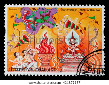 Bangkok Thailand - June 2010: A Thai postage stamp printed in Thailand depicting a Buddhist temple mural of Thai culture, circa 1997 - stock photo
