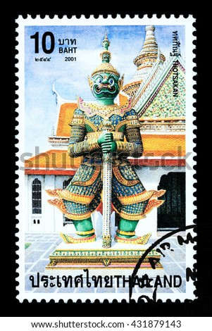 Bangkok Thailand - June 2010: A Thai postage stamp printed in Thailand depicting a traditional Thai Buddhist temple statue, circa 2001 - stock photo
