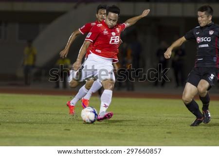 BANGKOK,THAILAND:JUNE 2015:(DF)Peerapat No.2;BEC(Red)-Tero Sasana-SCG Muangthong United(Back) at 72nd Anniversary Stadium;inThai Premier League on18July2015,Bangkok Thailand. - stock photo