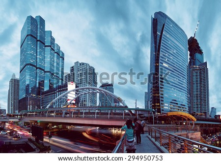 Bangkok, Thailand - June 26, 2015: Dusk time in downtown Bangkok intercection with traffic on the road, - stock photo