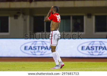 BANGKOK,THAILAND:JUNE 2015:(MF)Gilbert Koomson No.17;BEC-Tero Sasana(red)-SCG Muangthong United(back) at 72nd Anniversary Stadium;inThai Premier League on18July2015,Bangkok Thailand.  - stock photo