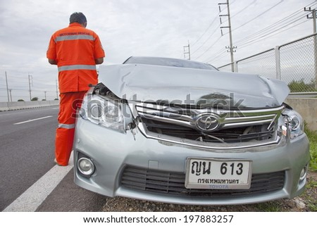 BANGKOK, THAILAND - JUNE 10:  Rescue forces in a deadly car accident scene on June 10 2014. Road accident coupe gray hit the SUV car on the freeway in rush hour.  - stock photo