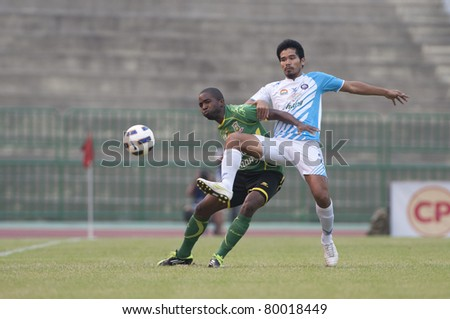 BANGKOK, THAILAND- JUNE 25 : S.Sukkha (R) in action during Thai Premier League (TPL) between Army Utd. (green) vs Chonburi fc (white) on June 25, 2011 at Army Stadium in Bangkok, Thailand - stock photo