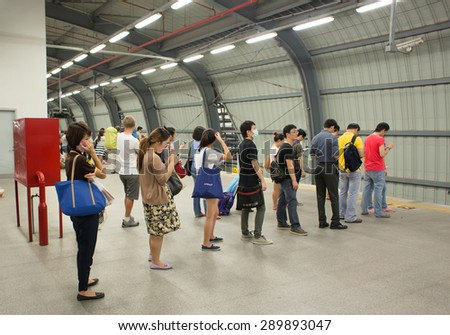 BANGKOK, THAILAND - JUNE 6 : Unidentified passengers waits for the Suvarnabhumi Airport Rail Link Train on June 6, 2015 in Bangkok, Thailand. Airport Rail Link opened for service on 23 August 2010. - stock photo