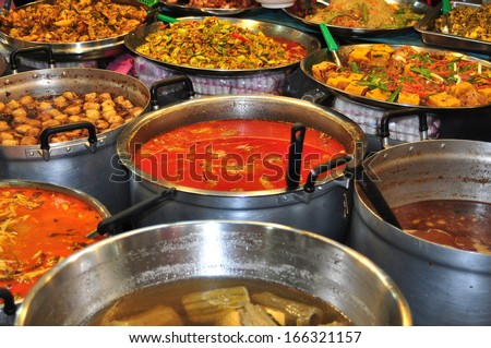 BANGKOK, THAILAND: Many delicious prepared Thai foods are sold at the daily Or Tor Kor Fresh Food Market - stock photo