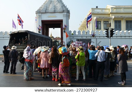 BANGKOK, THAILAND - MAR 26, 2015: Tourists visit the Grand Palace in Bangkok, Thailand on March 26 2015. Grand Palace in Bangkok is the most famous temple and landmark of Thailand. - stock photo
