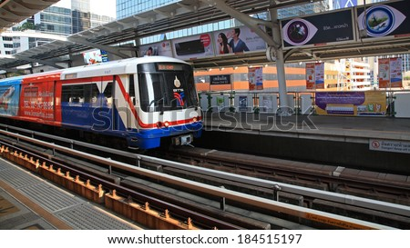 BANGKOK, THAILAND-MARCH 27, 2014: BTS Sky train arrives to Phloen Chit station. Elevated rails cover business, resident, and tourist areas by 32 stations. - stock photo