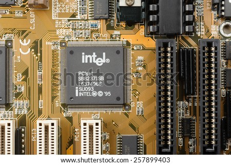 BANGKOK, THAILAND - MARCH 05, 2015: Early microprocessor on motherboard from Intel. Intel is one of the world's largest and highest valued semiconductor chip makers. - stock photo