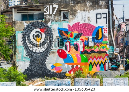 BANGKOK, THAILAND - 20 MARCH: Giant graffiti on abandon building of Bangkok on March 20, 2013. The building is leftover - stock photo