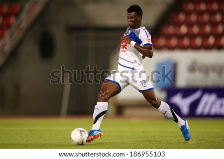 BANGKOK THAILAND-MARCH 09:Issac Honey of Air Force F.C. in action during Thai Premier League between Insee Police United.and Air Force F.C.at Thammasat Stadium on March 09, 2014,Thailand - stock photo