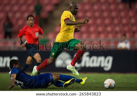 BANGKOK,THAILAND-MARCH 30:Jacques Zoua no.10(R) of Cameroon in action during the international friendly match between Thailand and Cameroon at Rajamangala Stadium on March30 2015 in,Thailand. - stock photo