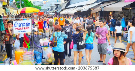BANGKOK, THAILAND - MARCH 03, 2013: People shopping in Chatuchak weekend market in Bangkok, Thailand.  It is the largest market in Thailand.  - stock photo